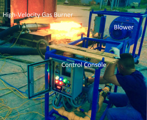 """Set up of the """"Gas Train"""" at the end of a cycle. The burner (left) is put into the work piece when fired off. This image shows what happens with the burner while in use."""